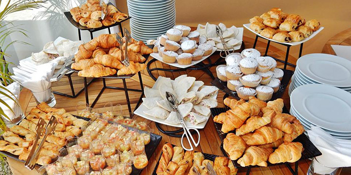An open breakfast buffet at the hotels' main restaurant, with a complete offer ranging from seasonal fruits to the popular English breakfast and Mauritian-style pancakes.